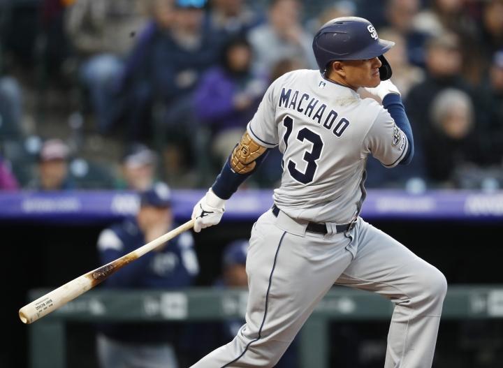 San Diego Padres' Manny Machado singles off Colorado Rockies starting pitcher Jon Gray during the sixth inning of a baseball game Saturday, May 11, 2019, in Denver. (AP Photo/David Zalubowski)