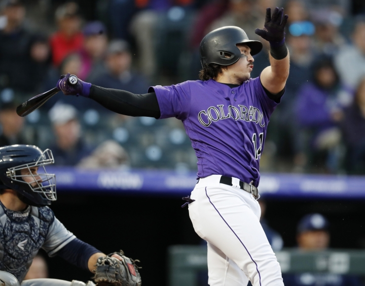 Colorado Rockies' Tony Wolters follows through on a single off San Diego Padres starting pitcher Joey Lucchesi during the fifth inning of a baseball game Saturday, May 11, 2019, in Denver. (AP Photo/David Zalubowski)