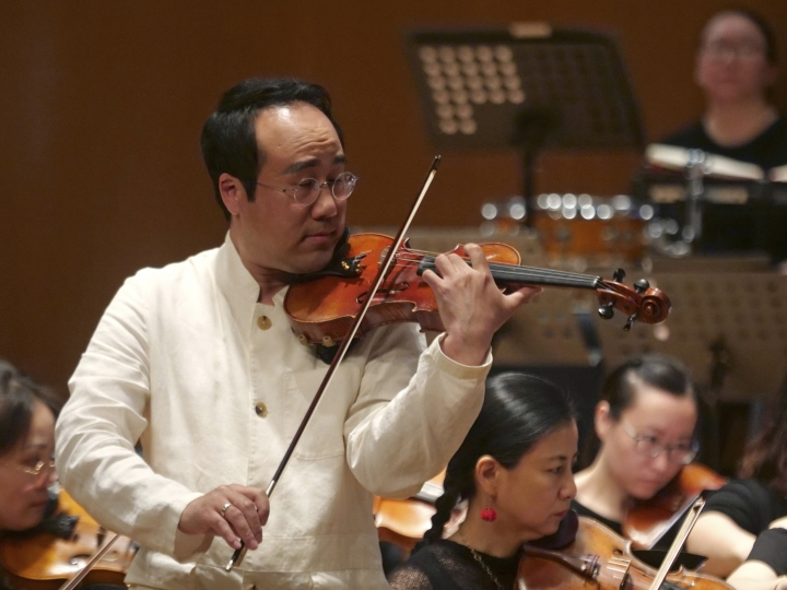 South Korean violinist Won Hyung Joon performs at the Shanghai Oriental Arts Center in Shanghai on Sunday, May 12, 2019. South Korean violinist Won and his North Korean soprano partner, Kim Song Mi perform in a rare joint performance they hope would help bring the divided Koreas closer together via music. Their performance comes three days after North Korea fired two suspected short-range missiles in the second such weapons test in five days.(AP Photo/Dake Kang)
