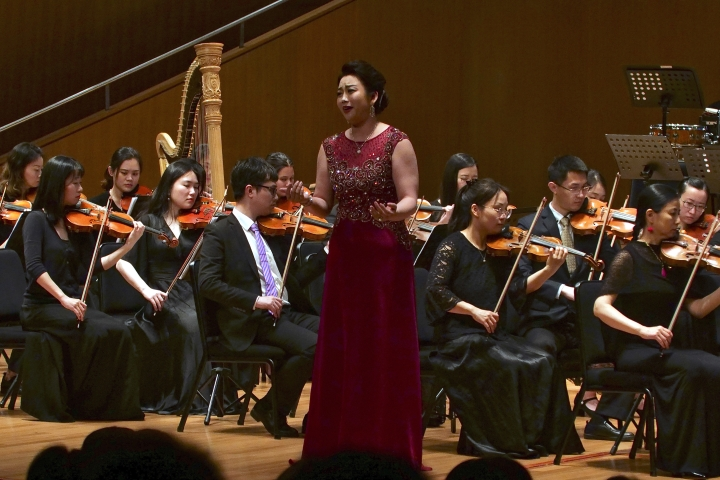 North Korean soprano singer Kim Song Mi performs at the Shanghai Oriental Arts Center in Shanghai on Sunday, May 12, 2019. South Korean violinist Won Hyung Joon and his North Korean soprano partner, Kim perform in a rare joint performance they hope would help bring the divided Koreas closer together via music. Their performance comes three days after North Korea fired two suspected short-range missiles in the second such weapons test in five days. (AP Photo/Dake Kang)
