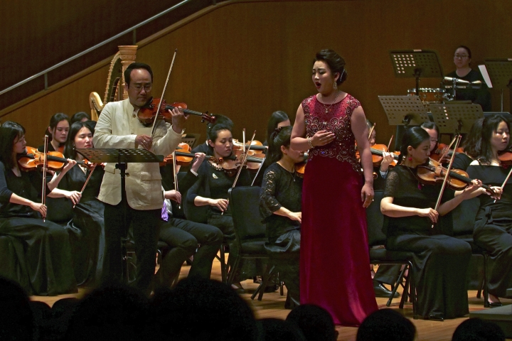 South Korean violinist Won Hyung Joon and his North Korean soprano partner, Kim Song Mi perform at the Shanghai Oriental Arts Center in Shanghai on Sunday, May 12, 2019. Won, a South Korean, performed together with Kim, a North Korean, in a rare joint performance they hope would help bring the divided Koreas closer together via music. Their performance comes three days after North Korea fired two suspected short-range missiles in the second such weapons test in five days. (AP Photo/Dake Kang)