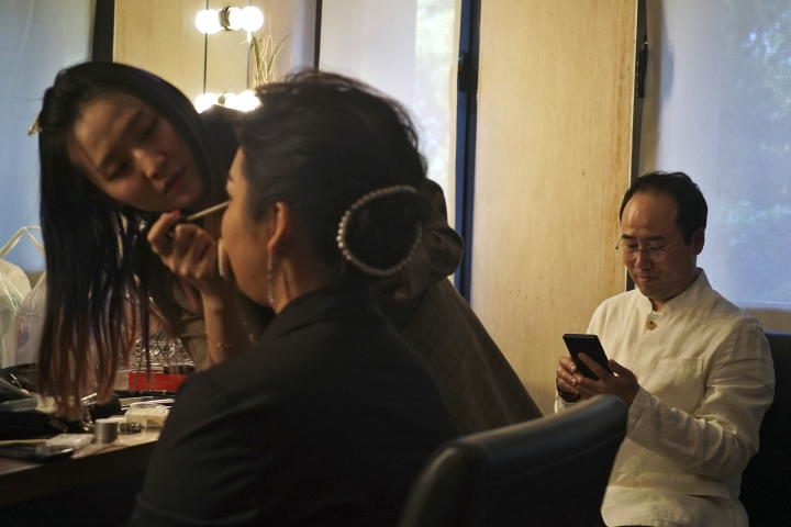 A makeup artist applies make-up for North Korean soprano singer Kim Song Mi next to South Korean violinist Won Hyung Joon at backstage before their performance at the Shanghai Oriental Arts Center in Shanghai, Sunday, May 12, 2019. Won, a South Korean, performed together with Kim, a North Korean, in a rare joint performance they hope would help bring the divided Koreas closer together via music. Their performance comes three days after North Korea fired two suspected short-range missiles in the second such weapons test in five days.(AP Photo/Dake Kang)