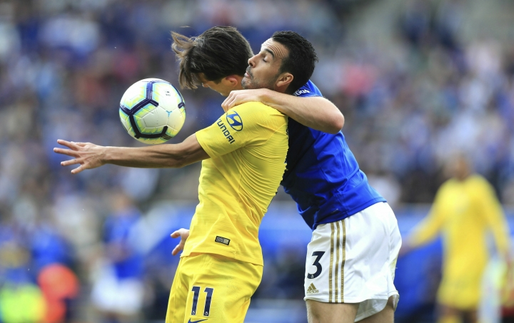 Chelsea's Pedro, left, and Leicester City's Ben Chilwell battle for the ball during their English Premier League soccer match at the King Power Stadium, Leicester, England, Sunday, May 12, 2019. (Mike Egerton/PA via AP)