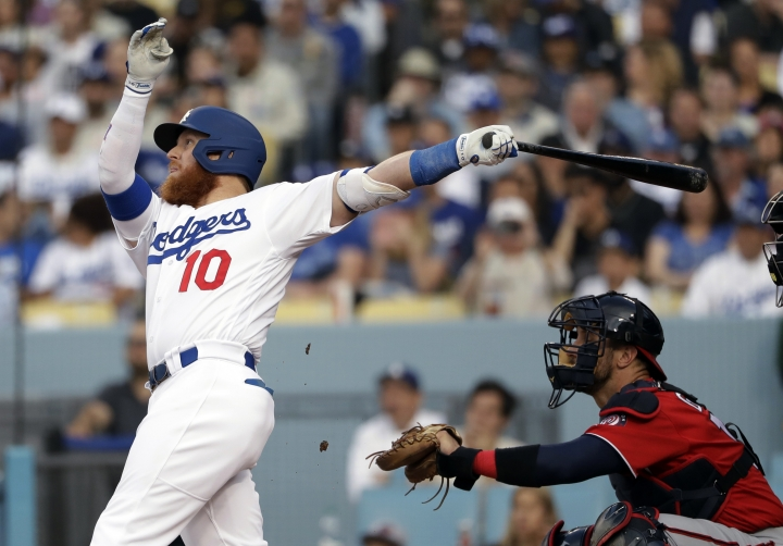 Los Angeles Dodgers' Justin Turner watches his two-run home run against the Washington Nationals during the third inning of a baseball game Saturday, May 11, 2019, in Los Angeles. (AP Photo/Marcio Jose Sanchez)