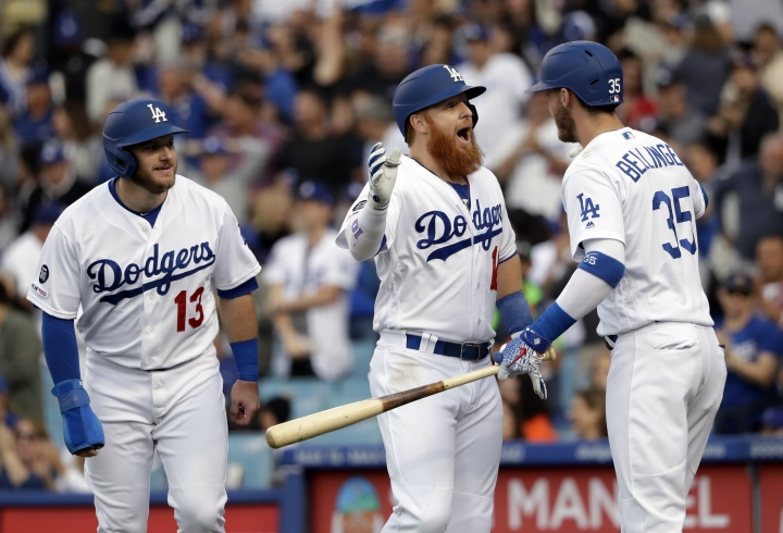 Los Angeles Dodgers' Justin Turner, center, celebrates his two-run home run with Max Muncy, left, and Cody Bellinger during the third inning of the team's baseball game against the Washington Nationals on Saturday, May 11, 2019, in Los Angeles. (AP Photo/Marcio Jose Sanchez)