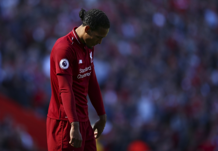 Liverpool's Virgil van Dijk reacts at the end of the English Premier League soccer match between Liverpool and Wolverhampton Wanderers at the Anfield stadium in Liverpool, England, Sunday, May 12, 2019. Despite a 2-0 win over Wolverhampton Wanderers, Liverpool missed out on becoming English champion for the first time since 1990 because title rival Manchester City beat Brighton 4-1. (AP Photo/Dave Thompson)