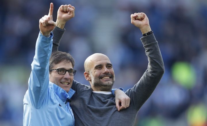 Manchester City coach Pep Guardiola, right, celebrates at the end of the English Premier League soccer match between Brighton and Manchester City at the AMEX Stadium in Brighton, England, Sunday, May 12, 2019. Manchester City defeated Brighton 4-1 to win the championship. (AP Photo/Frank Augstein)