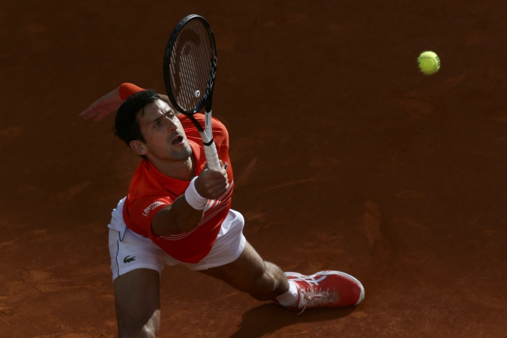 Serbia's Novak Djokovic plays a shot against Greece's Stefanos Tsitsipas during the final of the Madrid Open tennis tournament in Madrid, Spain, Sunday, May 12, 2019. (AP Photo/Bernat Armangue)