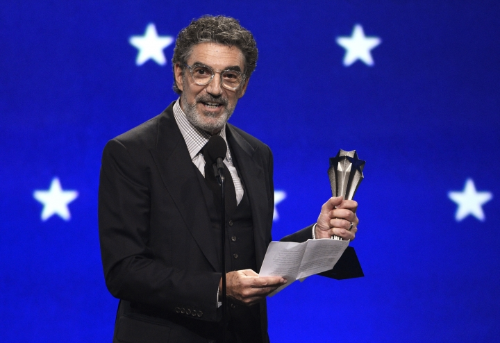 """FILE - In this Jan. 13, 2019, file photo, Chuck Lorre accepts the creative achievement award at the 24th annual Critics' Choice Awards at the Barker Hangar in Santa Monica, Calif. The end of """"The Big Bang Theory"""" means the beginning of a familiar debate: is the traditional sitcom, complete with laugh track, a thing of the past? The hit CBS comedy concludes its 12-year run on Thursday, May 16. (Photo by Chris Pizzello/Invision/AP)"""