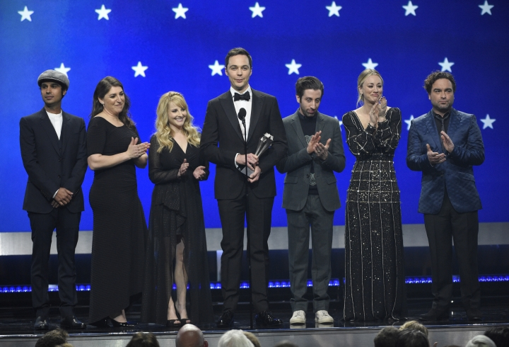 "FILE - In this Jan. 13, 2019, file photo, Kunal Nayyar, from left, Mayim Bialik, Melissa Rauch, Jim Parsons, Simon Helberg, Kaley Cuoco and Johnny Galecki, from the cast of ""The Big Bang Theory,"" present the creative achievement award at the 24th annual Critics' Choice Awards at the Barker Hangar in Santa Monica, Calif. Hugs and tears punctuated the final taping of ""The Big Bang Theory,"" a lovefest for its stars, crew and audience alike. There were plenty of punchlines as well, as the true-to-form hit comedy about scientists and those who love them wrapped the two-part, hour-long finale that will air in mid-May on CBS. (Photo by Chris Pizzello/Invision/AP, File)"