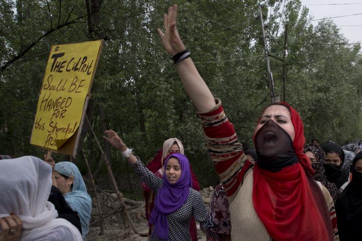 Kashmiri women shout slogans during a protest against the alleged rape of a 3 year old girl from north Kashmir at Mirgund, outskirts of Srinagar, Indian controlled Kashmir, Monday, May 13, 2019. (AP Photo/ Dar Yasin)