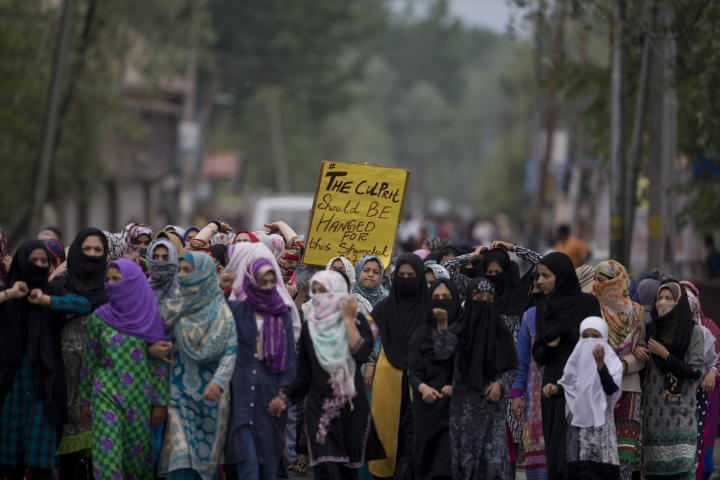 Kashmiri women participate in a protestagainst the alleged rape of a 3 year old girl from north Kashmir at Mirgund, outskirts of Srinagar, Indian controlled Kashmir, Monday, May 13, 2019. (AP Photo/ Dar Yasin)
