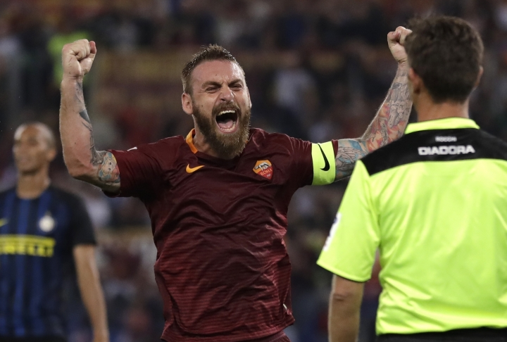 FILE - In this Oct. 2, 2016 file photo, Roma's Daniele De Rossi celebrates after his teammate Kostas Manolas scored during a Serie A soccer match between Roma and Inter Milan, at Rome's Olympic Stadium. Roma captain Daniele De Rossi surprisingly announced on Tuesday, May 14, 2019 he is leaving his hometown club after 18 years. (AP Photo/Andrew Medichini, file)