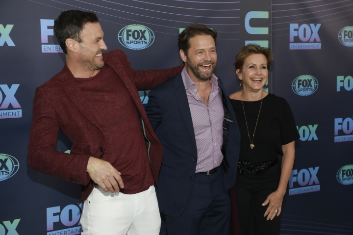 "Brian Austin Green, from left, Jason Priestley and Gabrielle Carteris, from the cast of ""BH90210,"" attend the FOX 2019 Upfront party at Wollman Rink in Central Park on Monday, May 13, 2019, in New York. (Photo by Andy Kropa/Invision/AP)"