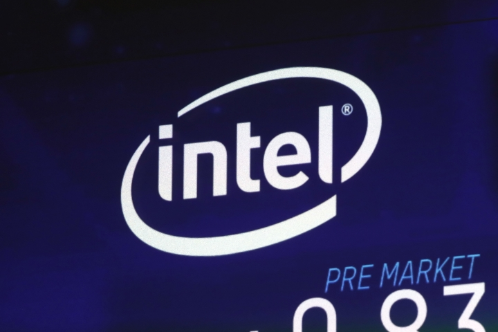 FILE - In this Oct. 3, 2018, file photo the Intel logo appears on a screen at the Nasdaq MarketSite, in New York's Times Square. Intel has revealed another hardware security flaw that could affects millions of machines around the world. The chipmaker said Tuesday, May 14, 2019, that there's no evidence of bad actors exploiting the bug, which is embedded in the architecture of computer hardware. (AP Photo/Richard Drew, File)