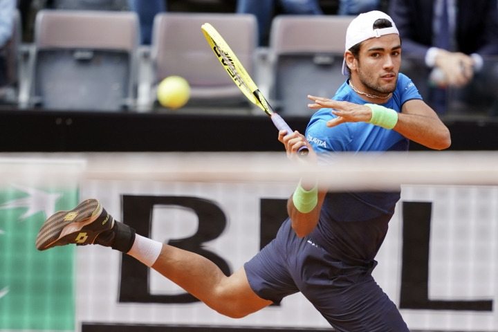 Matteo Berrettini, of Italy, returns the ball to Alexander Zverev, of Germany, at the Italian Open tennis tournament, in Rome, Tuesday, May, 14, 2019. (AP Photo/Andrew Medichini)