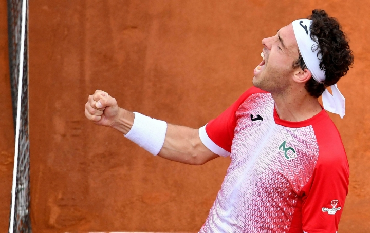 Marco Cecchinato of Italy celebrates after winning his men's singles first round match against Alex de Minaur of Australia, at the Italian Open tennis tournament in Rome, Italy, Monday, May 13, 2019. (Ettore Ferrari/ANSA via AP)