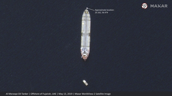 """This satellite image provided by Maxar Technologies shows the Saudi-flagged oil tanker Al Marzoqa off the coast of Fujairah, United Arab Emirates, Monday, May 13, 2019. As many as four oil tankers anchored in the Mideast were damaged in what Gulf officials described Monday as a """"sabotage"""" attack off the coast of the United Arab Emirates. (Satellite image ©2019 Maxar Technologies via AP)"""