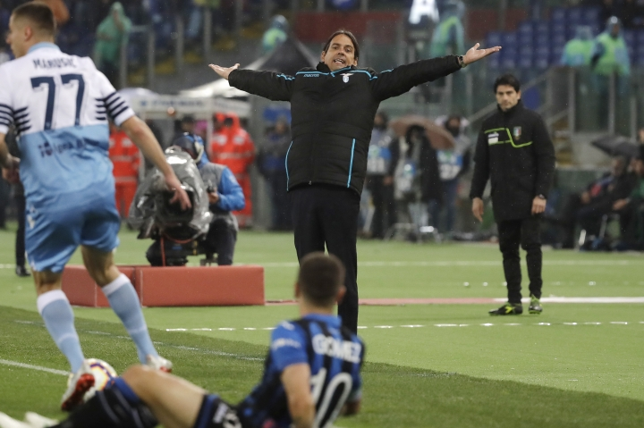 Lazio coach Simone Inzaghi gestures during the Italian Cup soccer final match between Lazio and Atalanta, at the Rome Olympic stadium, Wednesday, May 15, 2019. (AP Photo/Alessandra Tarantino)