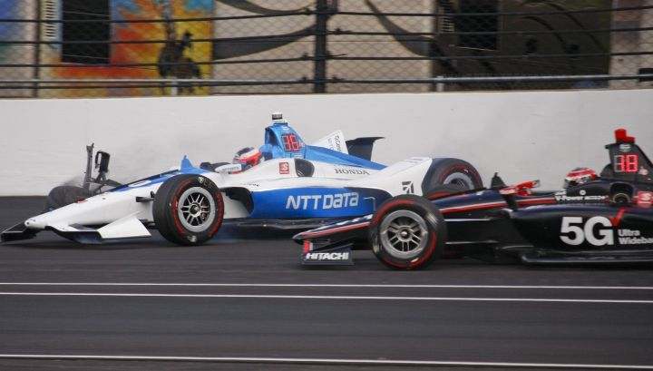 Will Power, of Australia, right, avoids the car driven by Felix Rosenqvist, of Sweden, after Rosenqvist hit the wall in the second turn during practice for the Indianapolis 500 IndyCar auto race at Indianapolis Motor Speedway, Wednesday, May 15, 2019 in Indianapolis. (AP Photo/Mike Fair)