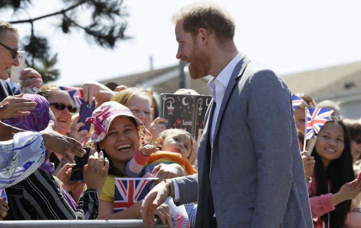 Britain's Prince Harry, The Duke of Sussex meets members of the public as he arrives for a visit to Barton Neighbourhood Centre in Oxford, England Tuesday, May 14, 2019. The centre is a hub for local residents which houses a doctor's surgery, food bank, cafe and youth club. (AP Photo/Kirsty Wigglesworth, pool)