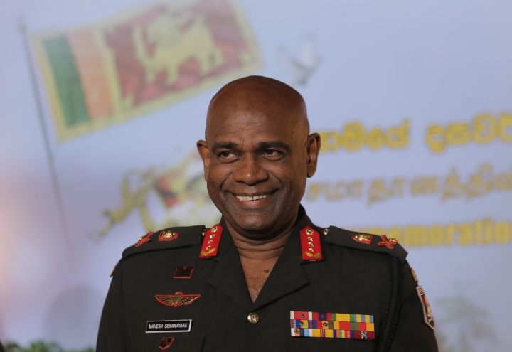 Sri Lankan army commander Lt. Gen. Mahesh Senanayake gestures as he arrives for a media briefing in Colombo, Sri Lanka, Thursday, May 16, 2019. Sri Lanka's army chief says other groups of Islamic extremists could be operating in the country independent of the one that carried out Easter Sunday bomb attacks. (AP Photo/Eranga Jayawardena)