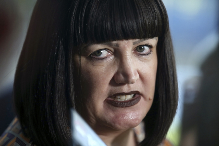 "Rugby Australia Chief Executive, Raelene Castle announces that Rugby Australia has terminated star fullback Israel Folau's contract in Sydney, Australia, Friday, May 17, 2019. Rugby Australia terminated Folau's contract after he was found guilty of a high-level breach of the players' code of conduct for a social media post that condemned gay people and other ""sinners"" to eternal damnation. (AP Photo/Rick Rycroft)"