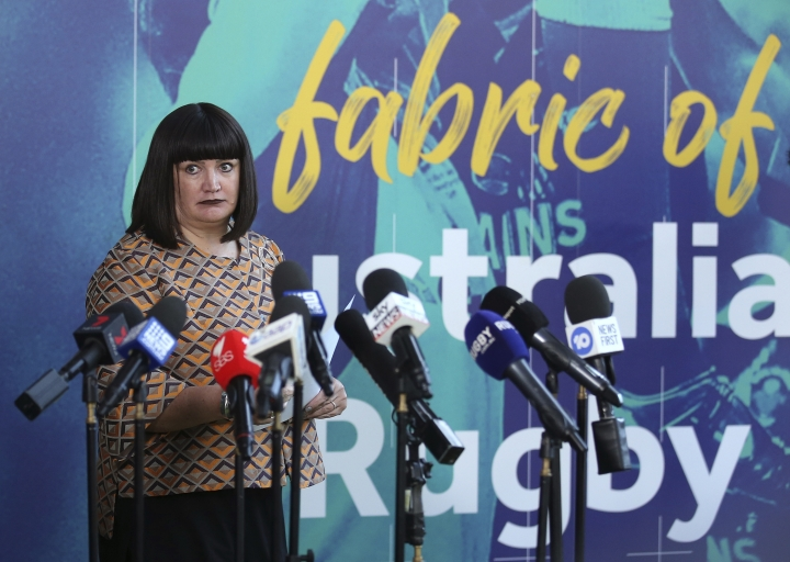 """Rugby Australia Chief Executive, Raelene Castle announces that Rugby Australia has terminated star fullback Israel Folau's contract in Sydney, Australia, Friday, May 17, 2019. Rugby Australia terminated Folau's contract after he was found guilty of a high-level breach of the players' code of conduct for a social media post that condemned gay people and other """"sinners"""" to eternal damnation. (AP Photo/Rick Rycroft)"""