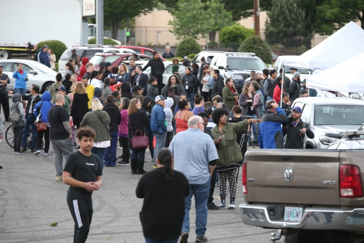 Students gather outside Parkrose High School during a lockdown after a man armed with a gun was wrestled to the ground by a staff member, Friday, May 17, 2019 in Portland, Ore. The Portland Police Bureau said in a statement Friday that no shots were fired at Parkrose High School, no one was injured and the man is in custody. Police say there are no other suspects. (Dave Killen/The Oregonian via AP)
