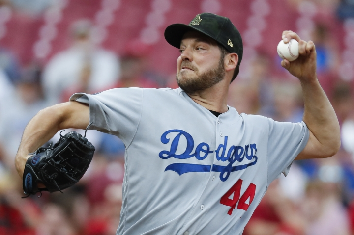 Los Angeles Dodgers starting pitcher Rich Hill throws in the first inning of a baseball game against the Cincinnati Reds, Friday, May 17, 2019, in Cincinnati. (AP Photo/John Minchillo)