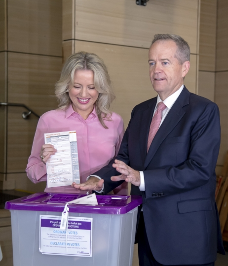 Australian opposition leader Bill Shorten poses as he votes with his wife Chloe during a federal election at Moonee Ponds West Primary School in Melbourne, Australia, Saturday, May 18, 2019. Polling stations opened across Australia on Saturday in elections that are likely to deliver the nation's sixth prime minister in as many years. (AP Photo/Andy Brownbill)