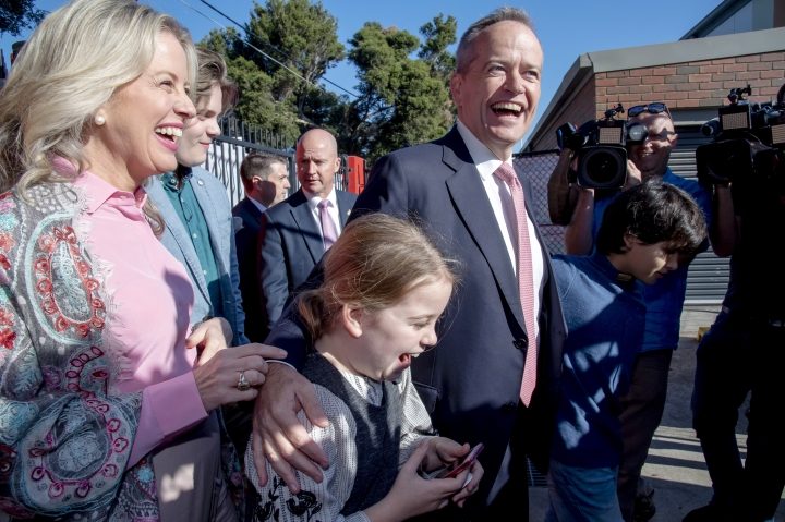 Australian opposition leader Bill Shorten, center, arrives with his wife Chloe, left, at a polling station for a federal election in Melbourne, Australia, Saturday, May 18, 2019. Polling stations opened across Australia on Saturday in elections that are likely to deliver the nation's sixth prime minister in as many years. (AP Photo/Andy Brownbill)