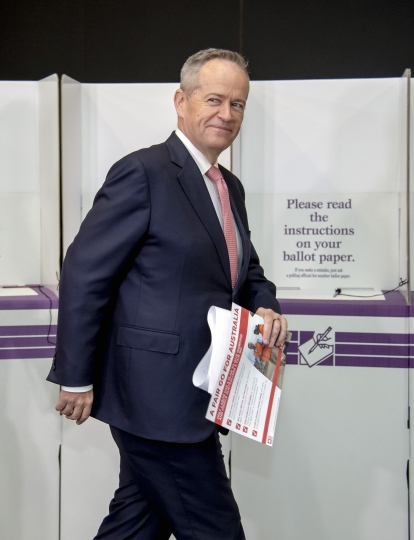Australian opposition leader Bill Shorten prepares to vote during a federal election at Moonee Ponds West Primary School in Melbourne, Australia, Saturday, May 18, 2019. Polling stations opened across Australia on Saturday in elections that are likely to deliver the nation's sixth prime minister in as many years. (AP Photo/Andy Brownbill)