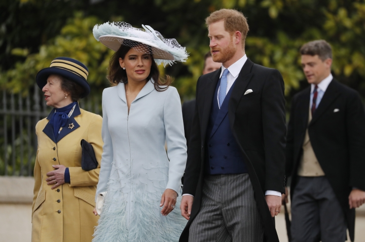 Britain's Prince Harry, second right, arrives with Lady Frederick Windsor, center, and Princess Anne, left, for the wedding of Lady Gabriella Windsor and Thomas Kingston at St George's Chapel, Windsor Castle, near London, England, Saturday, May 18, 2019. (AP Photo/Frank Augstein, Pool)