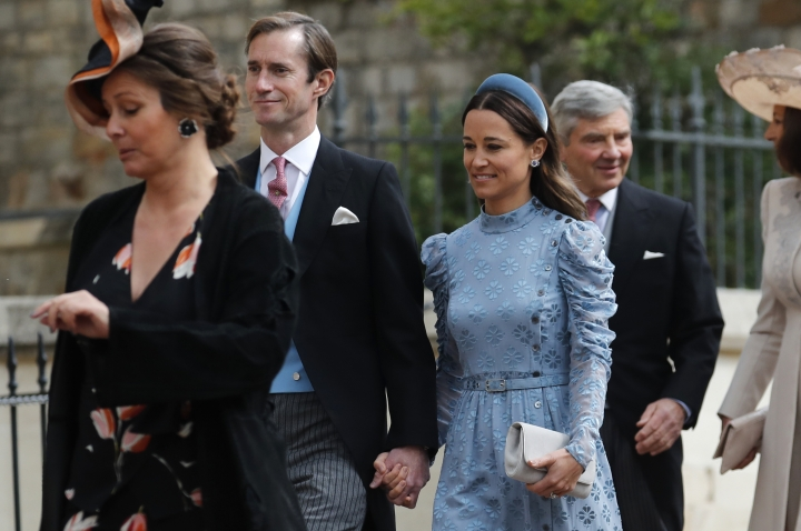 James Matthews, second left, and his wife Pippa, center, arrive for the wedding of Lady Gabriella Windsor and Thomas Kingston at St George's Chapel, Windsor Castle, near London, England, Saturday, May 18, 2019. (AP Photo/Frank Augstein, Pool)