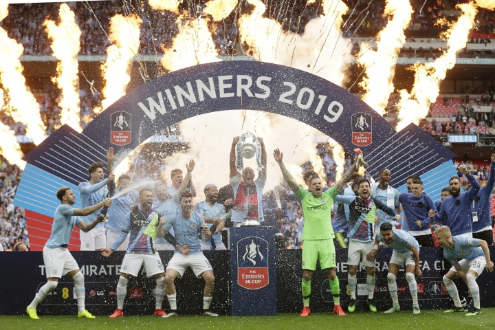 Manchester City players celebrate after winning the English FA Cup Final soccer match between Manchester City and Watford at Wembley stadium in London, Saturday, May 18, 2019. Manchester City won 6-0. (AP Photo/Tim Ireland)