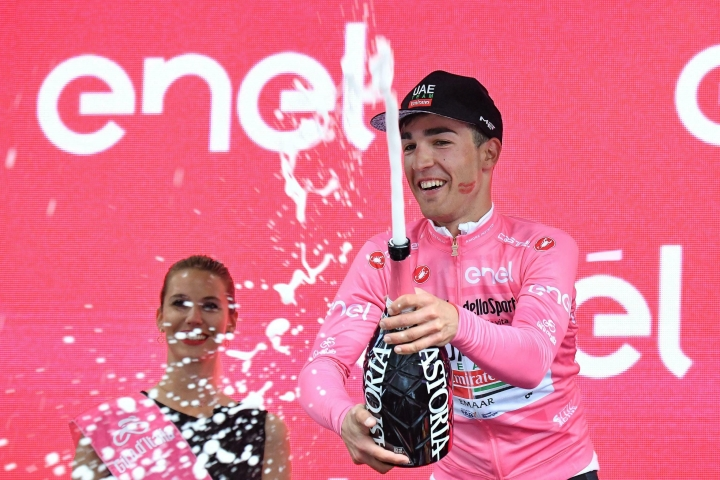 Italian rider Valerio Conti celebrates on podium after retaining the pink jersey of leader of the race during the eighth stage of the Giro d'Italia cycling race, from Tortoreto Lido to Pesaro, Italy, Saturday, May 18, 2019. (Alessandro Di Meo/ANSA via AP)