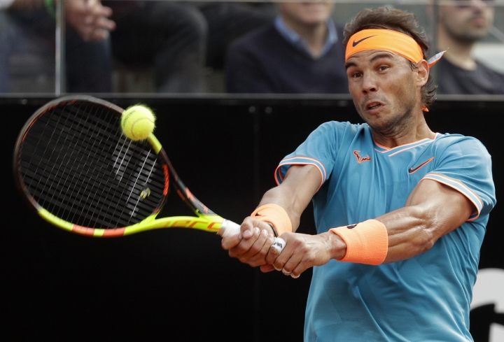 Rafael Nadal of Spain returns the ball to Novak Djokovic of Serbia during their final match at the Italian Open tennis tournament, in Rome, Sunday, May 19, 2019. (AP Photo/Gregorio Borgia)