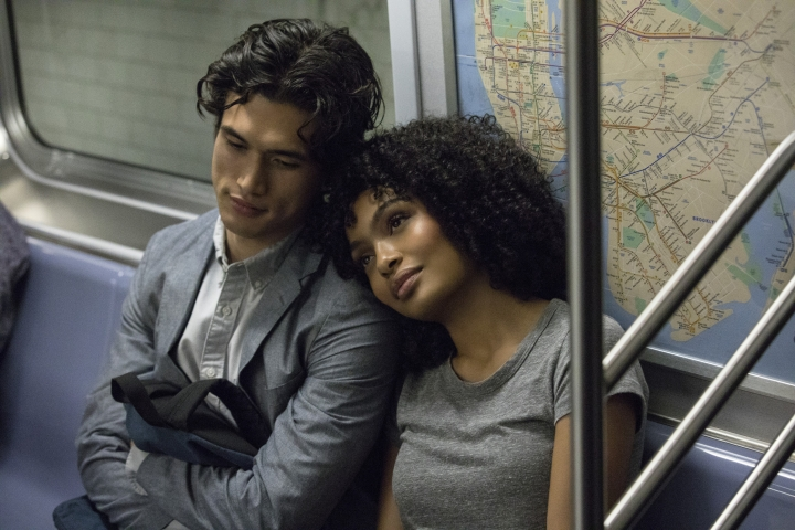 """In this image released by Warner Bros. Pictures, Charles Melton, left, and Yara Shahidi appear in a scene from the film """"The Sun Is Also a Star."""" (Atsushi Nishijima/Warner Bros. Pictures via AP)"""