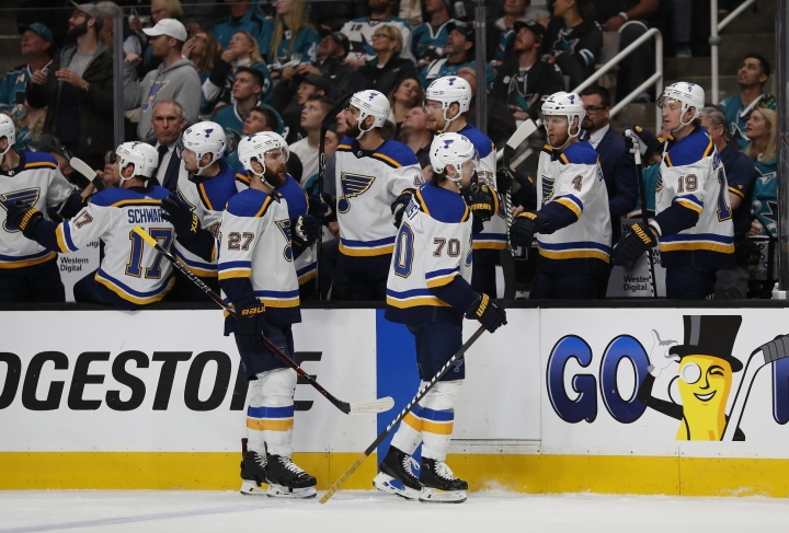 St. Louis Blues' Alex Pietrangelo (27) and Oskar Sundqvist (70) celebrate a goal against the San Jose Sharks with their bench in the first period in Game 5 of the NHL hockey Stanley Cup Western Conference finals in San Jose, Calif., Sunday, May 19, 2019. (AP Photo/Josie Lepe)