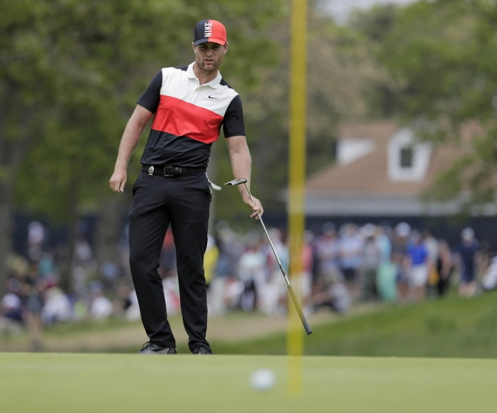 Lucas Bjerregaard, of Denmark, reacts to his putt on the third green during the final round of the PGA Championship golf tournament, Sunday, May 19, 2019, at Bethpage Black in Farmingdale, N.Y. (AP Photo/Julio Cortez)