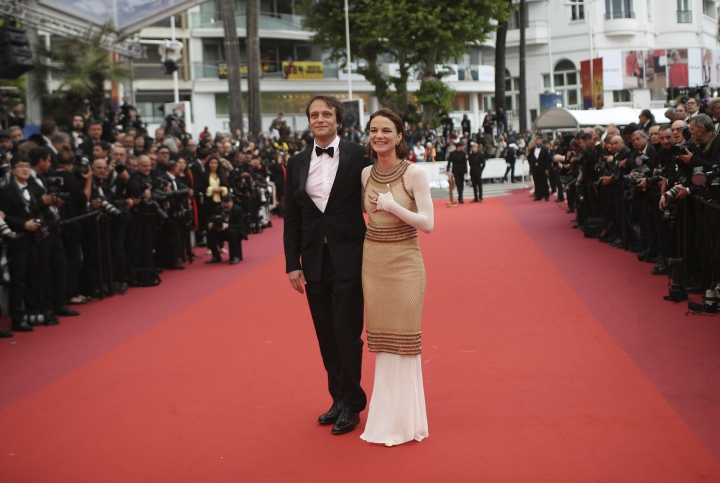 Actors August Diehl, left, and Valerie Pachner pose for photographers upon arrival at the premiere of the film 'A Hidden Life' at the 72nd international film festival, Cannes, southern France, Sunday, May 19, 2019. (AP Photo/Petros Giannakouris)
