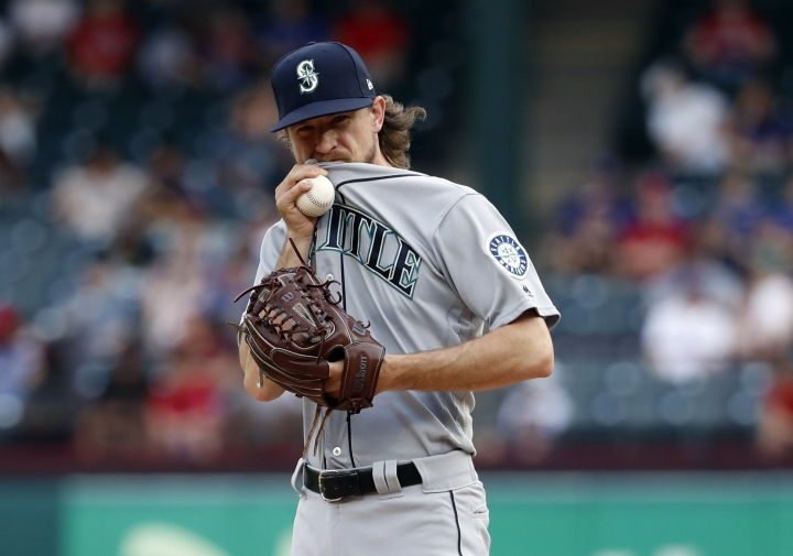 Seattle Mariners starting pitcher Mike Leake looks to the dugout as he works against the Texas Rangers in the first inning of a baseball game in Arlington, Texas, Monday, May 20, 2019. (AP Photo/Tony Gutierrez)