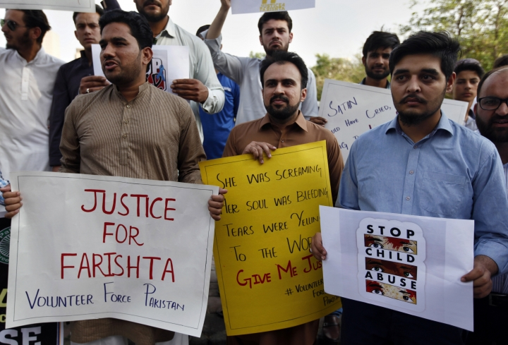 Members of the civil society group, Volunteer Force Pakistan, demonstrate to condemn the rape and killing of a girl, in Islamabad, Pakistan, Wednesday, May 22, 2019. Authorities in Pakistan suspended a police chief in the capital, Islamabad, over the disappearance, rape and killing of a 10-year-old girl whose case triggered widespread condemnation and outrage, including on social media. Officer Mohammad Imran says the chief, Mohammad Abbas, was suspended on Wednesday for failing to act promptly in the case. (AP Photo/Anjum Naveed)