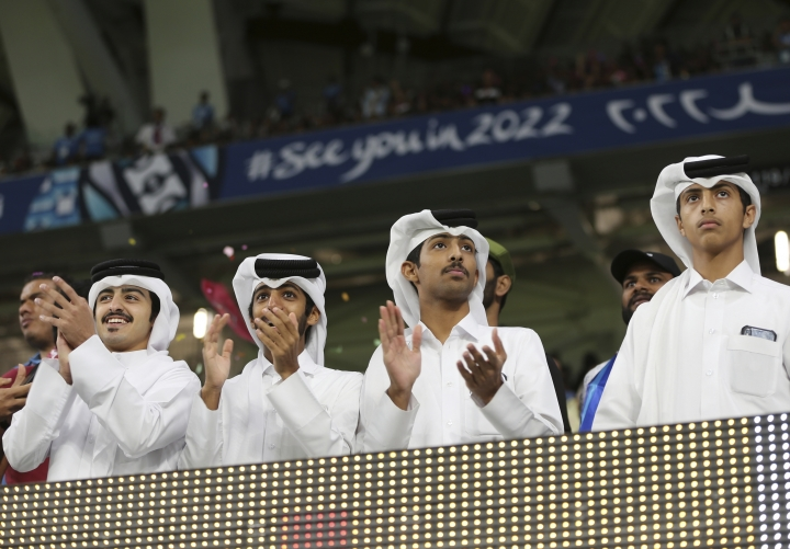 Qatari fans cheer during the Emir Cup final at the inauguration ceremony of the Al Wakrah stadium which is the first stadium has been built from the scratch for the 2022 FIFA World Cup, in Doha, Qatar, Thursday, May 16, 2019 photo, in Doha, Qatar. (AP Photo/Kamran Jebreili)
