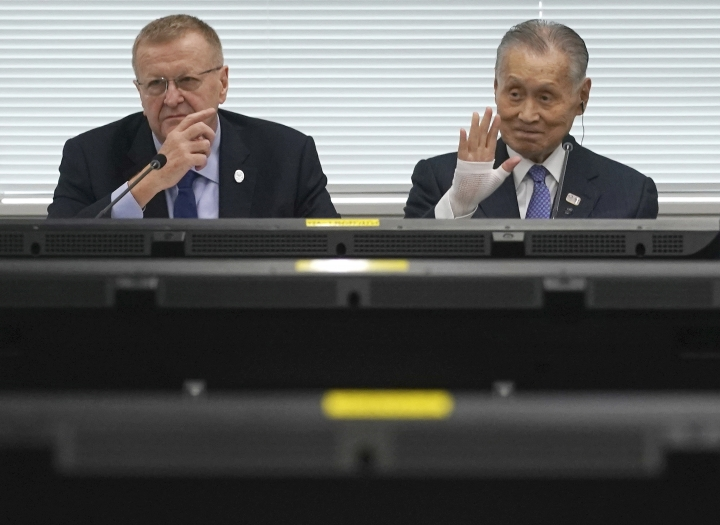 "FILE - In this May 21, 2019, file photo, John Coates, left, chairman of the IOC Coordination Commission for the 2020 Tokyo Olympics and Paralympics, Tokyo Olympic organizing committee President Yoshiro Mori, right, attend the IOC Coordination Commission opening plenary session of the Olympic Games Tokyo 2020 in Tokyo. A top Olympic official has made a guarantee that should please world sports federations that are concerned that organizers of next year's Tokyo games might be cutting things that federations view as ""essential."" (AP Photo/Eugene Hoshiko, File)"