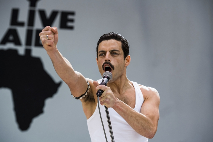 "This image released by Twentieth Century Fox shows Rami Malek in a scene from ""Bohemian Rhapsody."" The advocacy organization GLAAD says that LGBTQ representation is up for major studio films released in 2018. 20th Century Fox received a ""good"" rating for contributions for releases like ""Bohemian Rhapsody."" (Alex Bailey/Twentieth Century Fox via AP, File)"