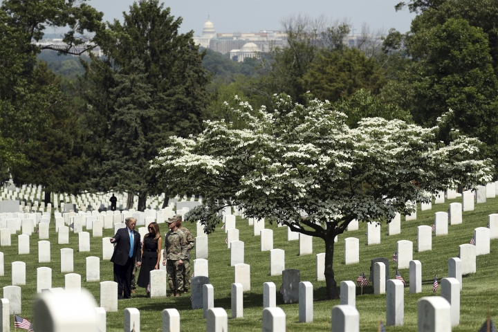 President Donald Trump and first lady Melania Trump visit Arlington National Cemetery for the annual Flags In ceremony ahead of Memorial Day Thursday, May 23, 2019, in Arlington, Va. (AP Photo/Andrew Harnik)