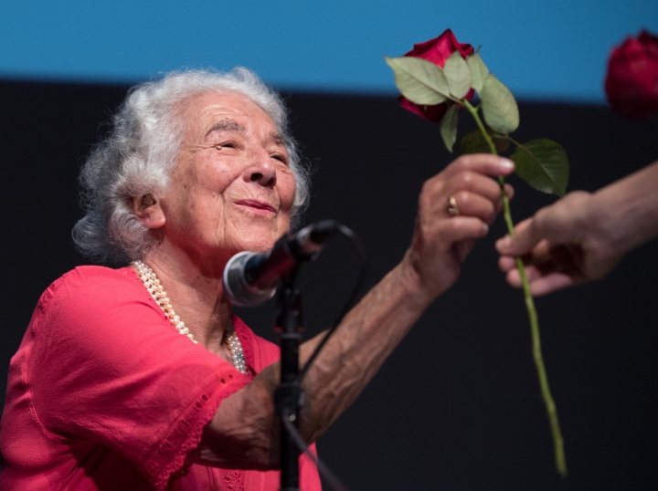 """FILE - In this Sept. 15, 2016 file photo British writer Judith Kerr holds a rose in Berlin, Germany. Judith Kerr, author and illustrator of the bestselling """"The Tiger Who Came to Tea"""" and other beloved children's books, has died at the age of 95. ( Soeren Stache/dpa via AP)"""