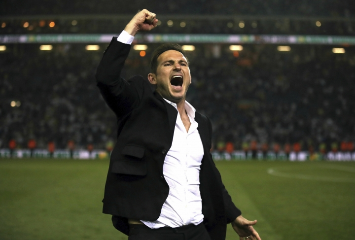 Derby County manager Frank Lampard celebrates victory after the English Championship Play-Off, Semi Final, Second Leg soccer match against Leeds United at Elland Road, Leeds, England, Wednesday May 15, 2019. (Nick Potts/PA via AP)